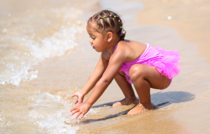 girl playing in safe beach water